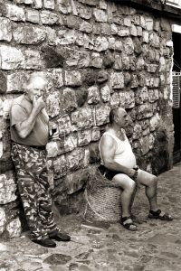 Abitanti di Cure presso Monte Isola, in Valcamonica